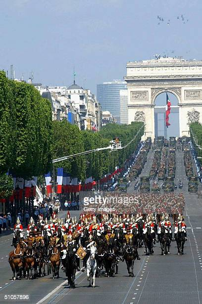 In this handout from the British Army the Kings's Troop Royal Horse Artillery draw two guns at the start of the annual Bastille Day Parade July 14...