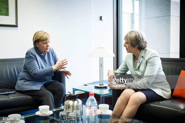 In this handout from the Bundesregierung German Chancellor Angela Merkel meets with British Prime Minister Theresa May on the sidelines of the EU...