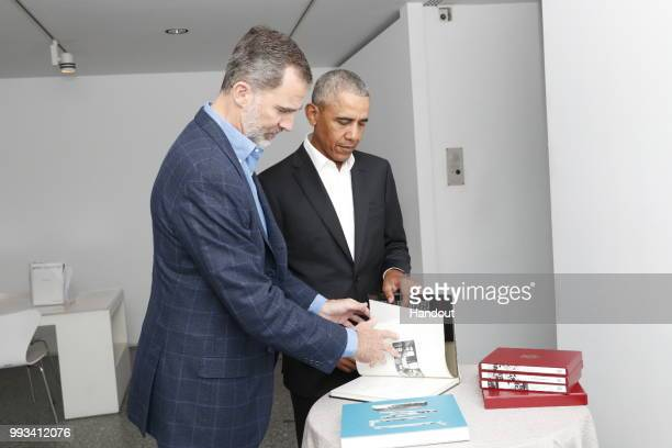 In this handout from the Casa Real - King Felipe VI of Spain and former President Barack Obama visit Reina Sofia museum on July 7, 2018 in Madrid,...
