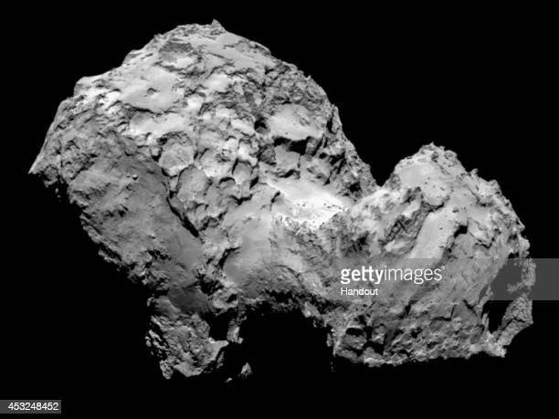 In this handout from the European Space Agency the comet Comet 67P/ChuryumovGerasimenko is seen in a photo taken by the Rosetta spacecraft with the...