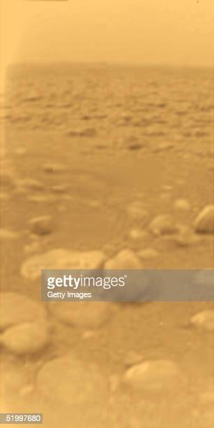 In this handout from the European Space Agncy , the first color picture from the European Space Agency's Huygens of the surface of Saturn's moon...