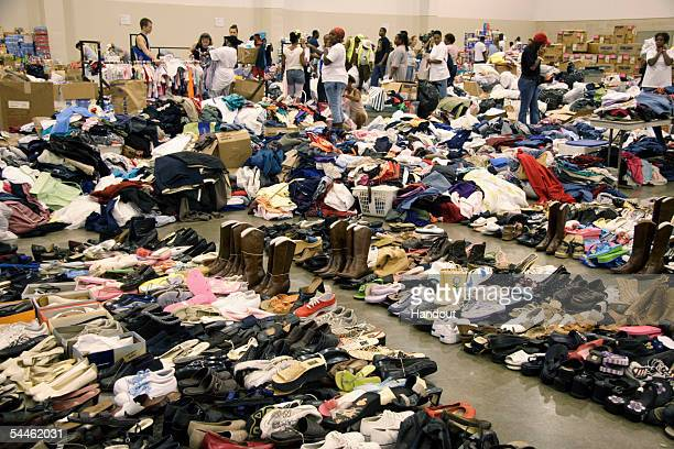 In this handout from the Federal Emergency Managment Agency Stockpiles of clothing food toothpaste shoes diapers and hundreds of other items are...