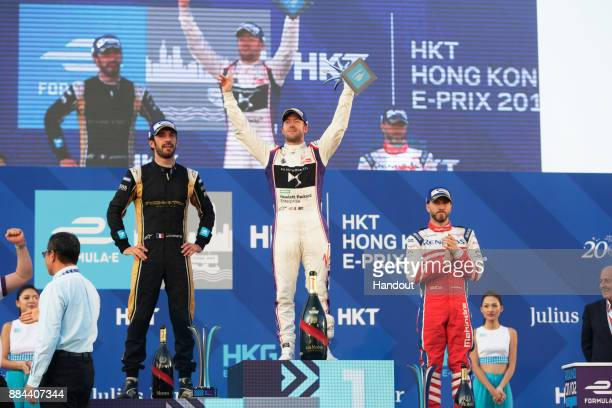 In this handout from the FIA Formula E Series Race winner Sam Bird DS Virgin Racing DS Virgin DSV03 celebrates on the podium with Jean Eric Vergne...
