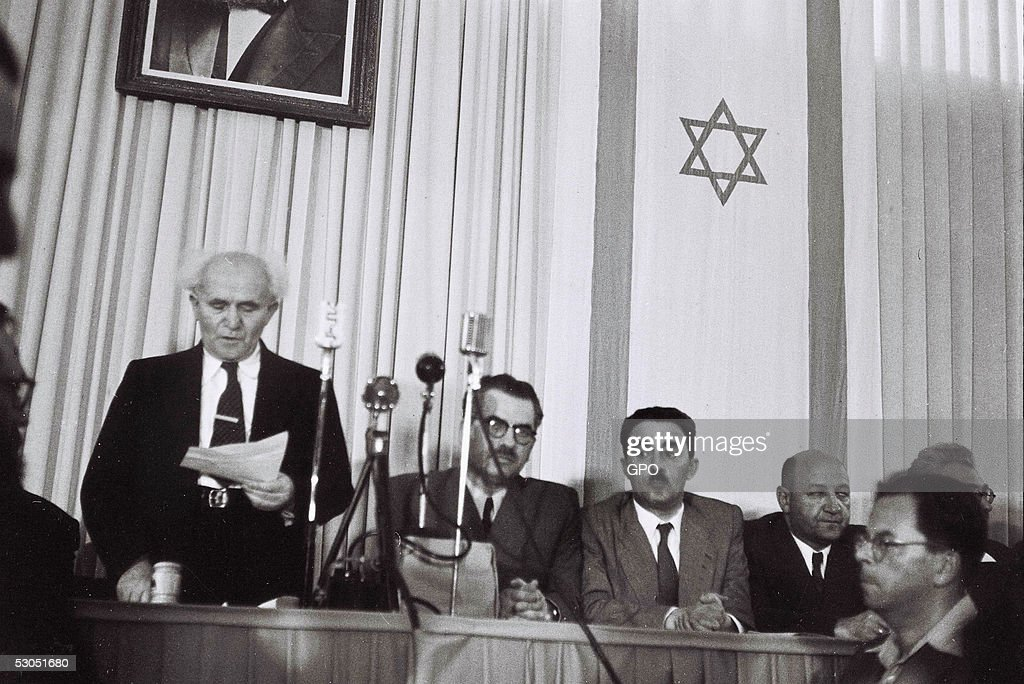 In this handout from the GPO, David Ben Gurion, who was to become Israel's first Prime Minister, reads the Declaration of Independence May 14, 1948 at the museum in Tel Aviv, during the ceremony founding the State of Israel.