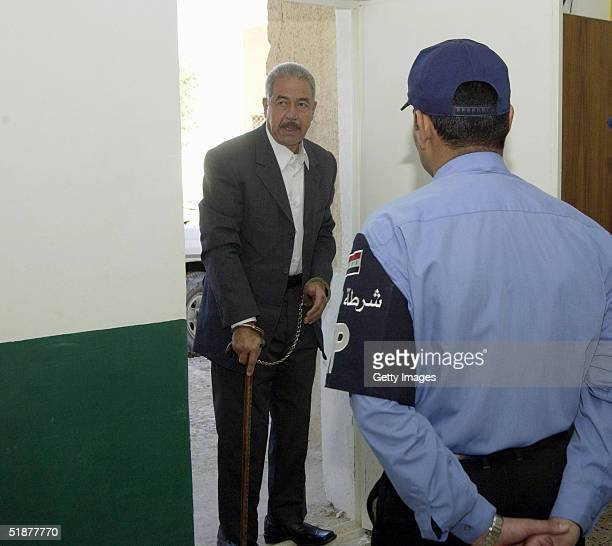 In this handout from the Iraqi Special Tribunal Ali Hassan alMajid Saddam Hussein's cousin known as 'Chemical Ali' arrives in handcuffs prior to...