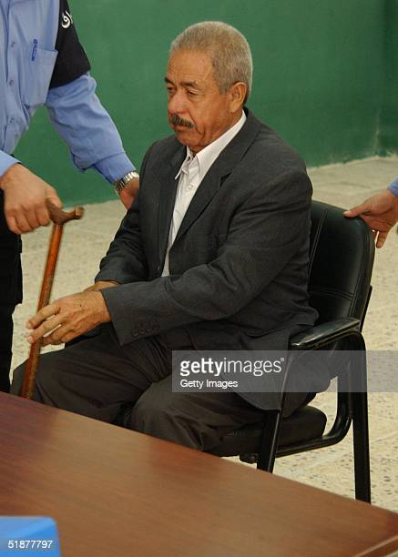 In this handout from the Iraqi Special Tribunal Ali Hassan alMajid Saddam Hussein's cousin known as 'Chemical Ali' appears before a judge of the...