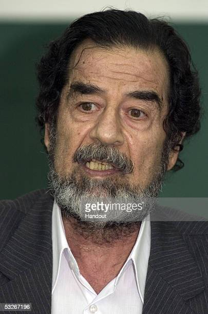 In this handout from the Iraqi Special Tribunal former Iraqi president Saddam Hussein speaks at an initial appearance before by the Iraqi Special...