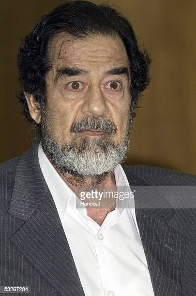In this handout from the Iraqi Special Tribunal former Iraqi president Saddam Hussein apears at an initial interrogation session before by the Iraqi...
