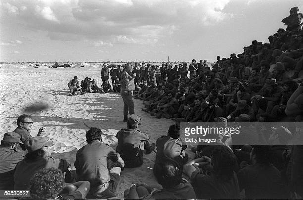 In this handout from the Israeli Governmental Press Office, Southern Command General Ariel Sharon addresses his troops on the western bank of the...