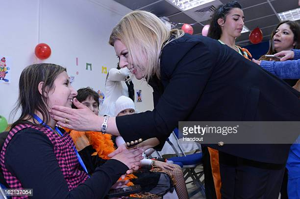 In this handout from the Israeli GPO Israeli Prime Minister Benjamin Netanyahu's wife Mrs Sara Netanyahu speaks to a child as she hosts child cancer...
