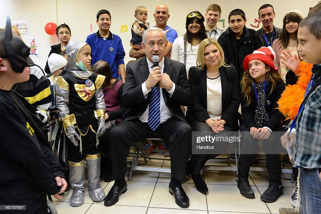 In this handout from the Israeli GPO, Israeli Prime Minister Benjamin Netanyahu and his wife Mrs. Sara Netanyahu hosts child cancer patients of the 'Rachashei Lev' support center ahead of the Jewish holiday of Purim on February 19, 2013 in an unspecified city in Israel. Netanyahu. Rachashei Lev was founded in 1989 to support children and their families suffering and in treatment from cancer.