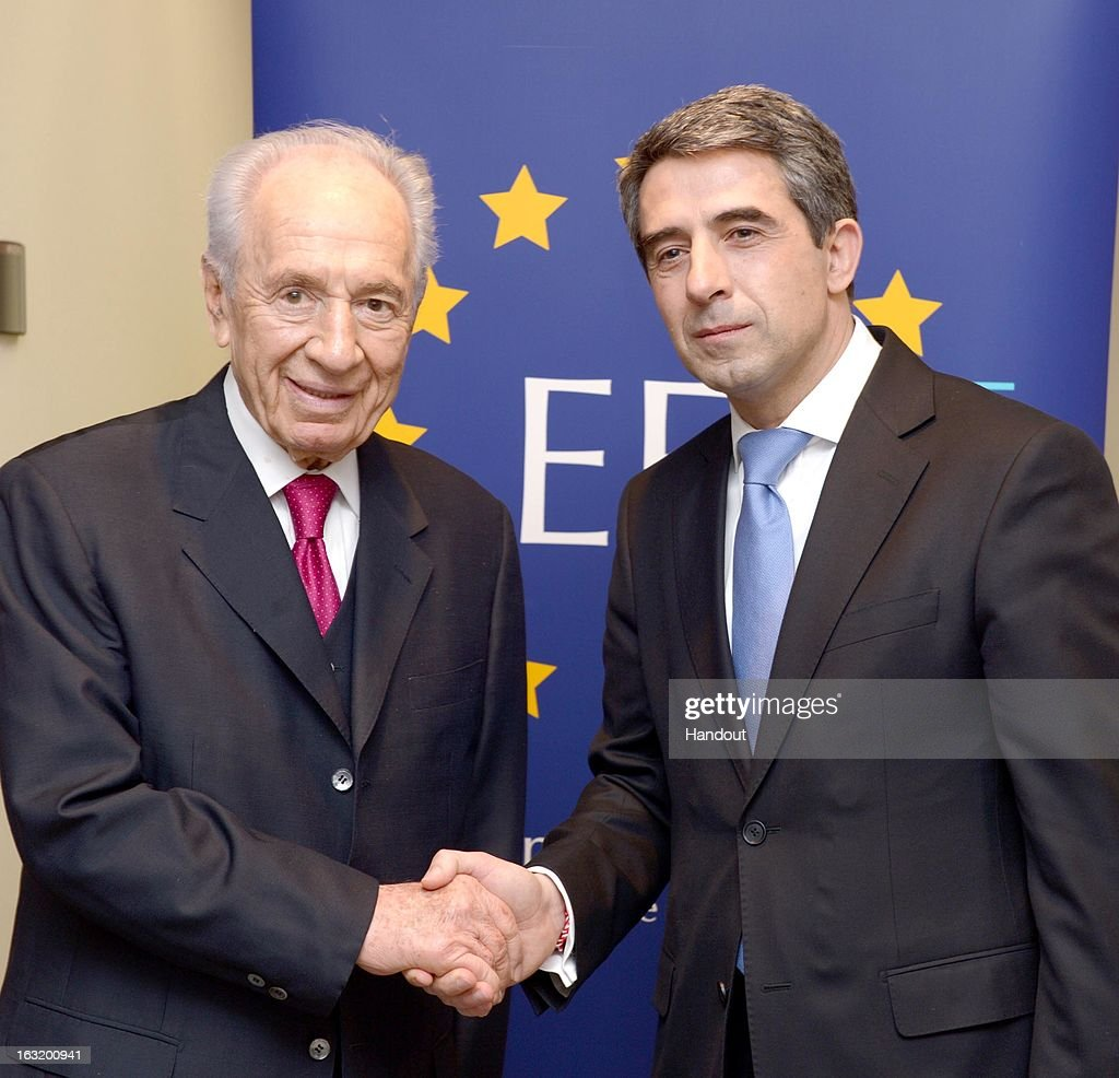 In this handout from the Israeli GPO, Israel's President Shimon Peres (L) and Bulgarian President Rosen Plevneliev greet at the event of 70th Anniversary of saving Bulgarian Jews from the Nazies during WW II at the European Parliament on March 6, 2013 in Brussels, Belgium. Peres is traveling to Brussels, Paris and Strasbourg where he will address the European Parliament, a first for an Israeli leader.