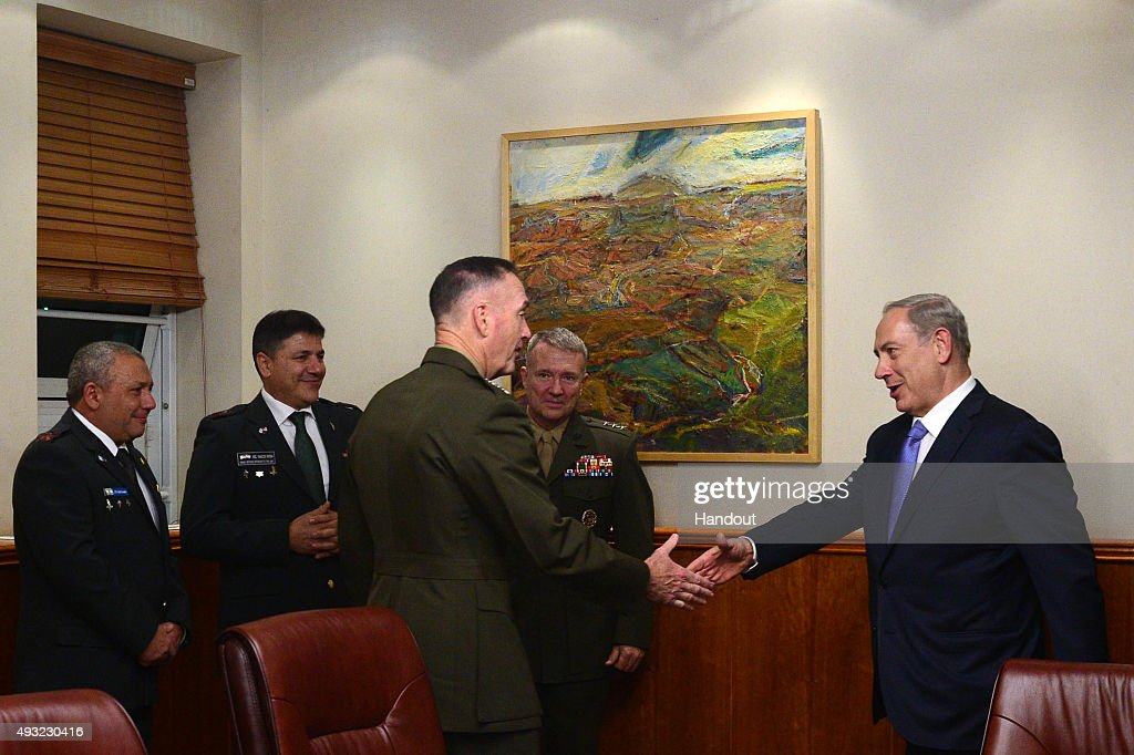 In this handout from the Israeli GPO, Prime minister Benjamin Netanyahu (R) shakes hands with Chairman of U.S. Joint Chiefs of Staff Marine General Joseph Dunford as they meet on October 18, 2015 in Jerusalem, Israel.