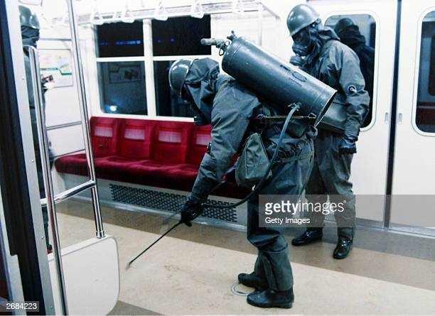 In this handout from the Japanese Defence Agency, personnel of the Self Defence Agency are seen clearing Sarin off platforms after the 1995 Sarin gas...