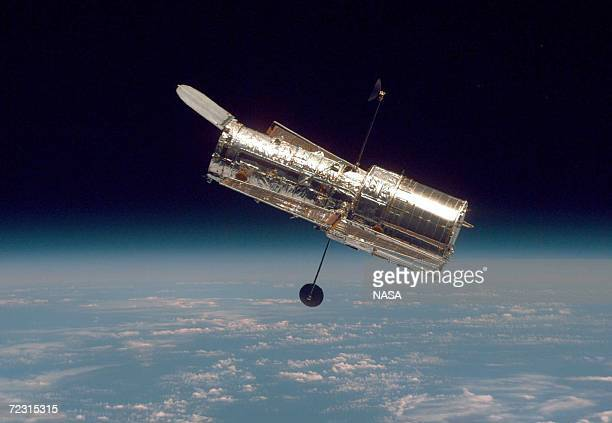 In this handout from the National Aeronautical Space Administration the Hubble Space Telescope drifts through space in a picture taken from the Space...
