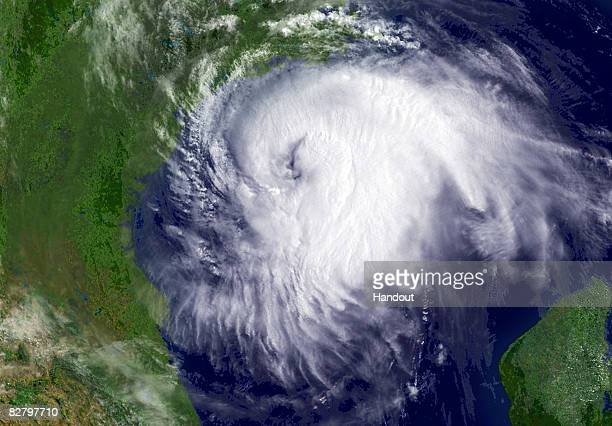 In this handout from the National Oceanic and Atmospheric Administration Hurricane Ike churns in the Gulf of Mexico at 1555 GMT September 12 2008 An...