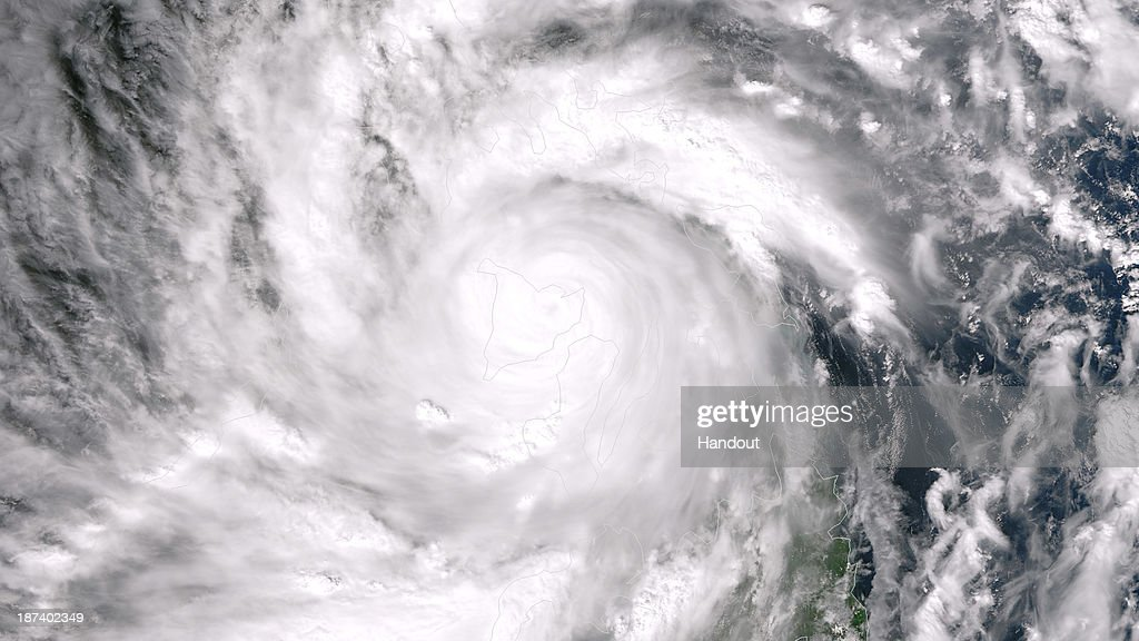 In this handout from the National Oceanic and Atmospheric Administration (NOAA), Super Typhoon Haiyan moves over the Philippines on November 8, 2013 from space. Haiyan, A category-5 typhoon being called one of the strongest storms on record, slammed into the Philippines November 8, with gusts up to 186 mile per hour (300 kilometers per hour) and sustained winds thought to be up to 195 miles per hour