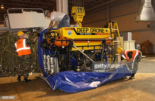 In this handout from the Navy Visual News Service members of the 89th Aerial Port Squadron and 32nd APS Air Reserve Squadron Pittsburgh PA load Deep...