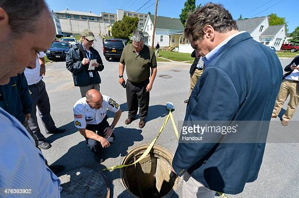 In this handout from the New York State Governor's Office, New York Gov. Andrew Cuomo is shown the manhole where two convicted murderers escaped from...