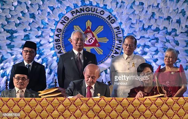 In this handout from the Presidential Photo Division, President Benigno S. Aquino III and Malaysian Prime Minister Dato' Sri Haji Mohammad Najib bin...