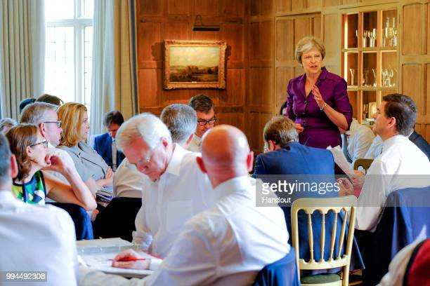 In this handout from the Prime Minister's Office Prime Minister Theresa May and members of her Cabinet meet at her country retreat Chequers on July 6...