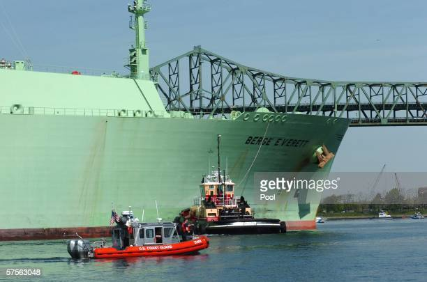 In this handout from the US Coast Guard a US Coast Guard boat helps the Liquified Natural Gas container ship Berge Everett as it comes inbound May 8...