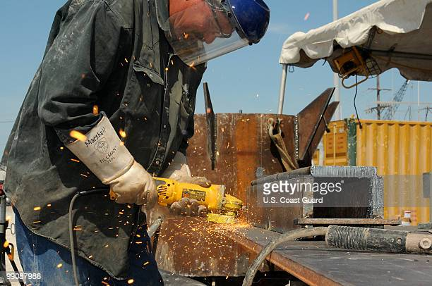 In this handout from the US Coast Guard A worker fabricates a pollution containment chamber at Wild Well Control Inc May 10 2010 in Port Fourchon...