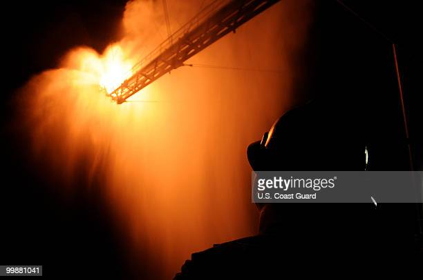 In this handout from the US Coast Guard Gas from the damaged Deepwater Horizon wellhead is burned by the drillship Discoverer Enterprise May 16 2010...
