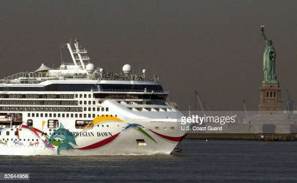 In this handout from the U.S. Coast Guard, the cruise ship Norwegian Dawn arrives April 18, 2005 in New York City. The ship made an unscheduled stop...