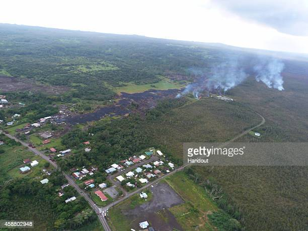 In this handout from the US Geological Survey the June 27th lava flow from the Kilauea volcano moves November 10 2014 in Pahoa Hawaii According to...
