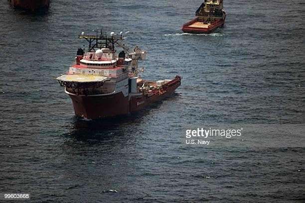 In this handout from the US Navy a ship actively participating in cleanup efforts patrols in the vicinity of the source of the oil spill May 13 2010...