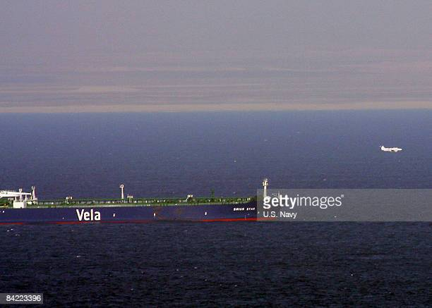 In this handout from the US Navy A small aircraft flies past he MV Sirius Star after dropping a parachute January 9 2009 in the Indian Ocean The...