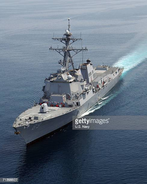 In this handout from the US Navy the Arleigh Burkeclass guided missile destroyer USS Mustin sails April 13 2005 in the Persian Gulf The technically...