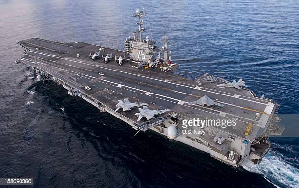 In this handout from the US Navy the X47B Unmanned Combat Air System demonstrator taxies on the flight deck of the aircraft carrier USS Harry S...