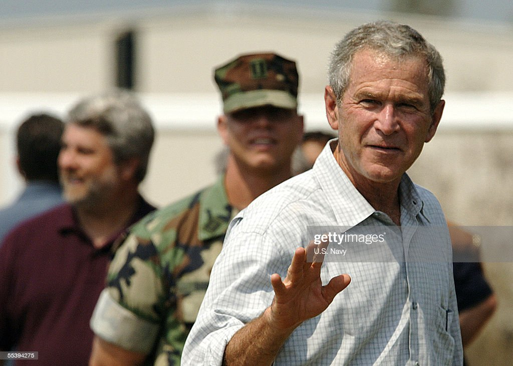 In this handout from the U.S. Navy, U.S. President George W. Bush waves to U.S. Navy Seabees during his visit to the 28 Street Elementary School September 12, 2005 in Biloxi, Mississippi. Bush visited the Gulf Coast for the third time since Hurricane Katrina swept though 15 days ago.