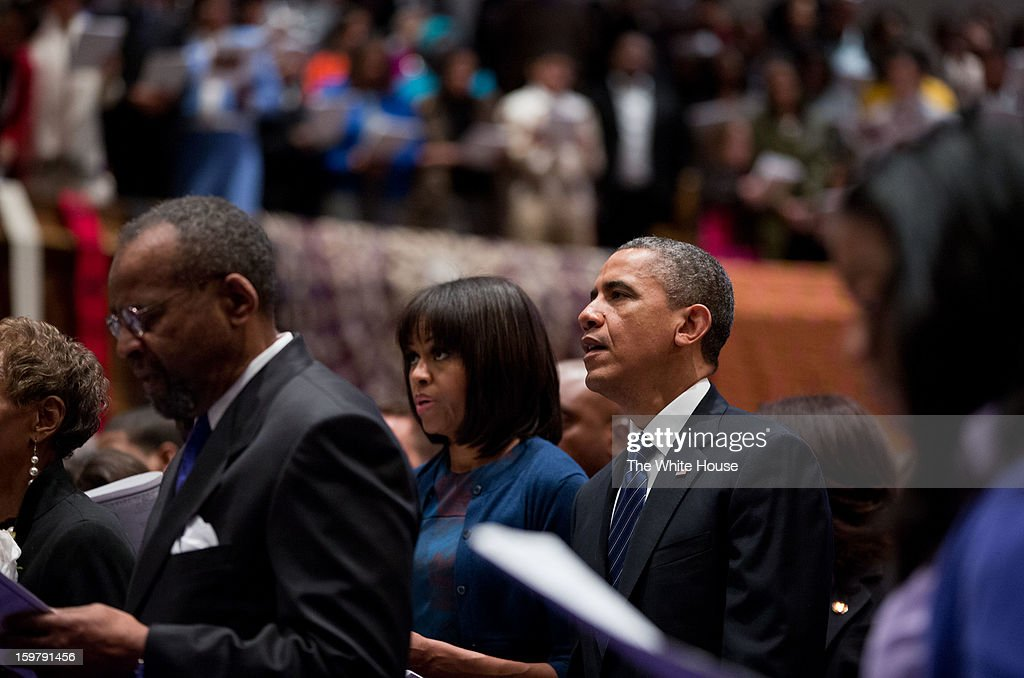 In this handout from the White House, U.S. President Barack Obama (2nd R) and first lady Michelle Obama (C) attend a church service at Metropolitan African Methodist Episcopal Church January 20, 2013 in Washington, DC.