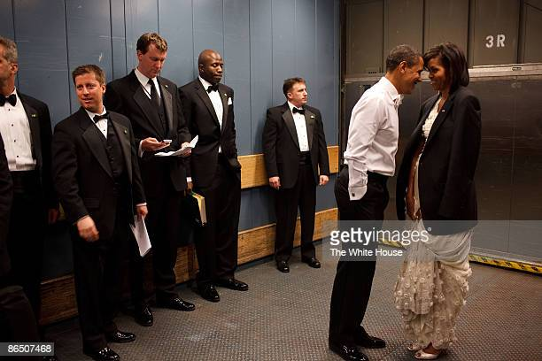 In this handout from the White House US President Barack Obama and first lady Michelle Obama together in a freight elevator at an Inaugural Ball...