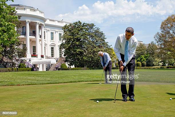 In this handout from the White House US President Barack Obama and US Vice President Joe Biden putt on the White House putting green April 24 2009 in...