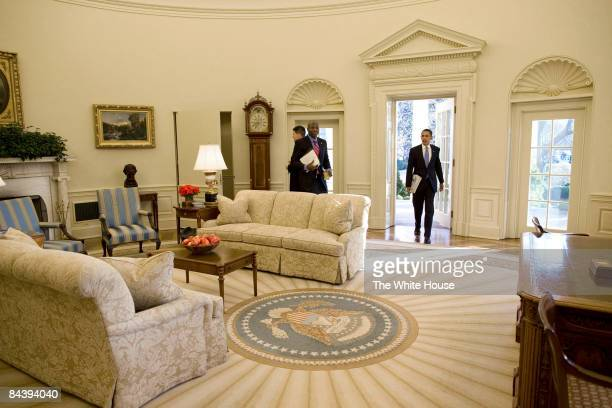 In this handout from the White House, U.S. President Barack Obama walks into the Oval Office of the White House in the morning January 21, 2009 in...