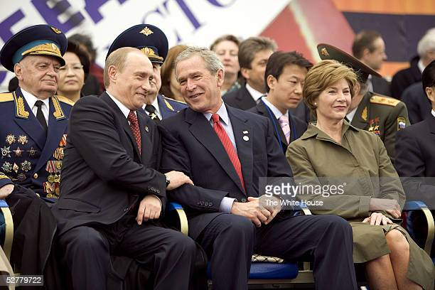 In this handout from the White House US President George W Bush and Russian President Vladimir Putin share a light moment as they sit with Laura Bush...