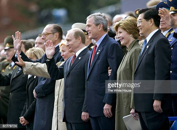 In this handout from the White House US President George W Bush and Laura Bush stand with Russian President Vladimir Putin and Ludmila Putina French...