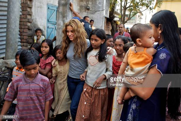 In this handout from United Nations Children's Fund , Shakira, an UNICEF ambassador, walks with a group of working children, who attend a UNICEF...