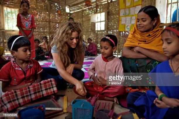 In this handout from United Nations Children's Fund Shakira an UNICEF ambassador sits with children at a Bangladesh Rural Advancement Committee...