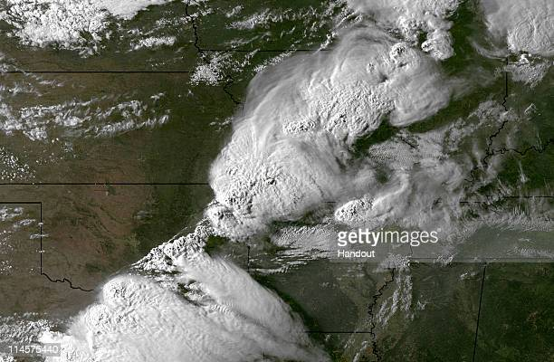 In this handout GOES East sattillte image provided by National Oceanic and Atmospheric Administration ,shows the storm system moments before spawning...