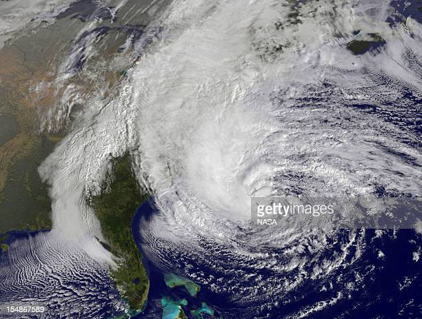 In this handout GOES satellite image provided by NASA Hurricane Sandy pictured at 1410 UTC churns off the east coast on October 28 2012 in the...