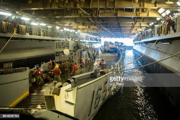 In this handout imade provided by the USNavy Landing craft utilities prepare to depart the well deck of the amphibious assault ship USS Kearsarge to...