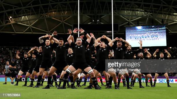 In this handout image by the World Rugby, New Zealand players perform the Haka prior to the Rugby World Cup 2019 Group B game between New Zealand and...