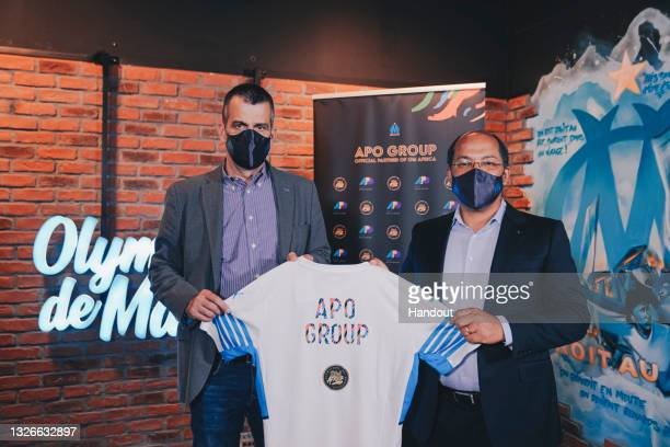 In this handout image distributed via APO Group, from Olympique de Marseille Managing Director, Laurent Colette, and APO Group Founder and Chairman,...