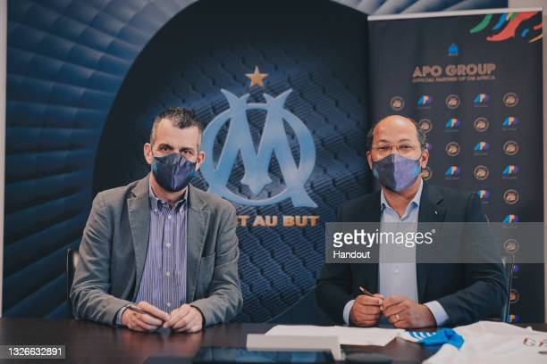 In this handout image distributed via APO Group, fromOlympique de Marseille Managing Director, Laurent Colette, and APO Group Founder and Chairman,...