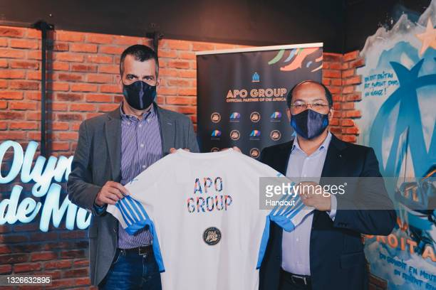 In this handout image distributed via APO Group, Olympique de Marseille Managing Director, Laurent Colette, and APO Group Founder and Chairman,...